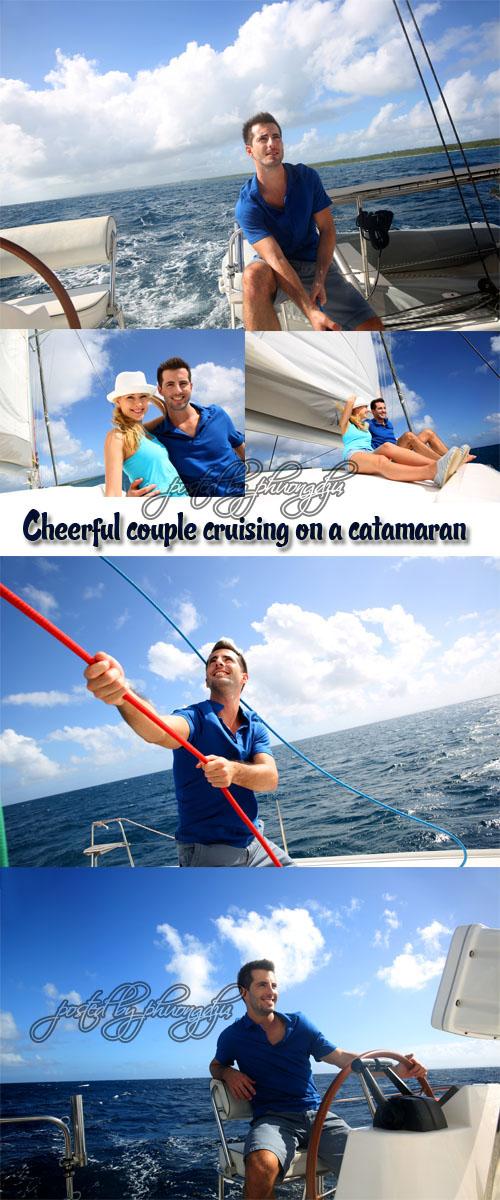 Stock Photo: Cheerful couple cruising on a catamaran in Caribbean sea